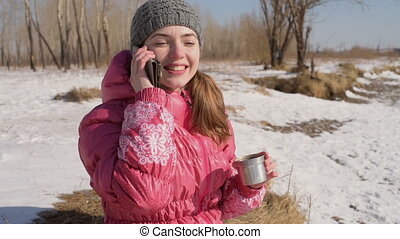 Woman with a phone in winter
