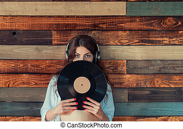 Woman with a phonograph record - Young woman with a...