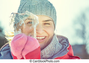 woman with a piece of ice