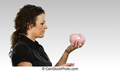 Woman with a piggy bank - HD footage of a woman with a Piggy...