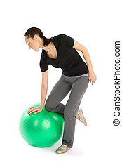 Woman with a Pilates Ball - Pretty fit woman with a pilates...