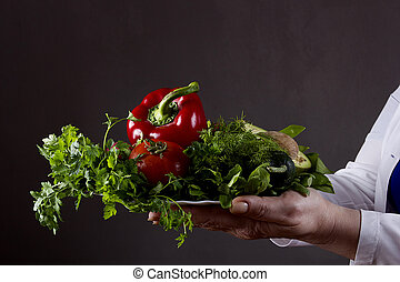 Woman with a plate of vegetables