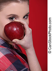 Woman with a red apple