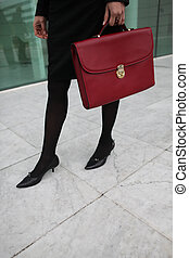 Woman with a red briefcase