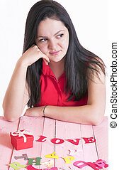 Woman with a red gift and the word love