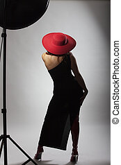 woman with a red hat from behind
