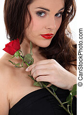 Woman with a red rose
