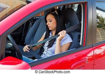 Woman with a seat belt in a car