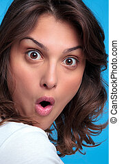 Woman with a shocked expression - Portrait of an attractive ...