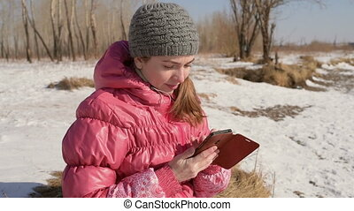 Woman with a smartphone outdoors