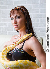 Woman with a snake holding red apple