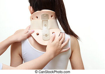 woman with a surgical cervical collar suffering from neck...