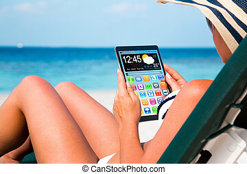 Woman with a tablet in hands - Woman on vacation lies in a...