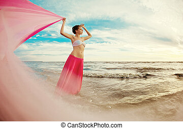 Woman with a tissue in his hands on the beach