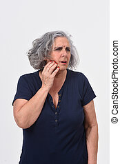 woman with a toothache on white background