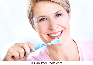 Woman with a  toothbrush