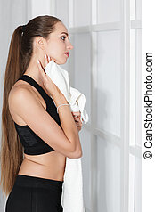 woman with a towel after a workout