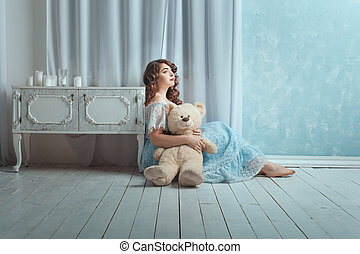 Woman with a toy bear. - Beautiful woman with overweight...