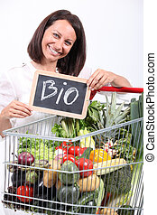 Woman with a trolley of organic vegetables