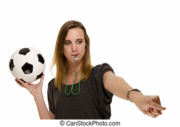 woman with a whistle holding a football pointing at something on white background