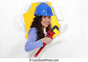 Woman with a wrench and hardhat