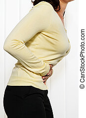 Woman with pain in the abdomen and groin. Menstrual pain.