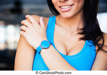 Woman with activity tracker