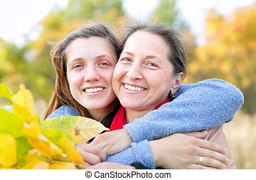 woman with adult daughter in autumn