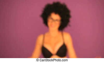 Woman with afro stepping into focus