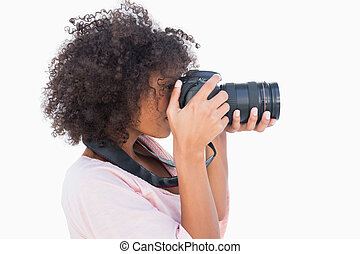 Woman with afro taking a photo