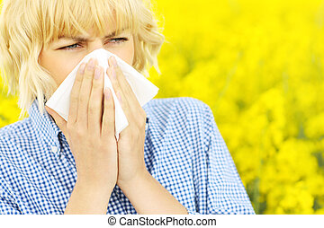 Woman with allergy over flowers