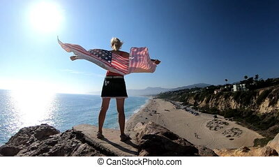 Woman with American flag in California