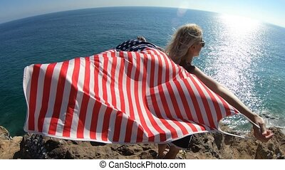 Woman with American flag in California - Woman waving an...