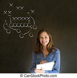 Woman with American football strategy on blackboard -...