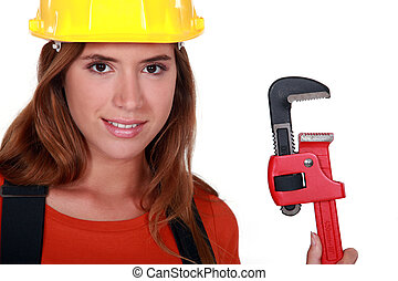 Woman with an adjustable wrench