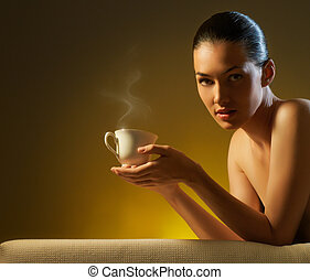 aromatic coffee - Woman with an aromatic coffee in hands
