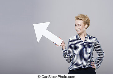 Woman with an arrow on grey background