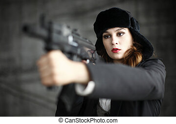Woman with an assault rifle