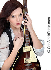 Woman with an electric guitar