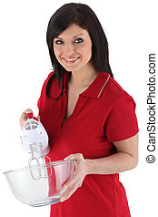 Woman with an electric whisk