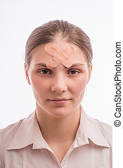 woman with an injury on his forehead