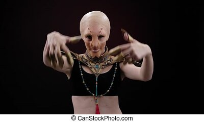 Woman with an ugly alien profassional makeup for a horror movie or halloween. . a heroine from a horror movie or an costume for Halloween