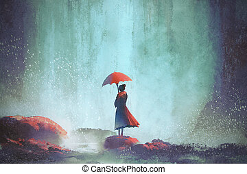 woman with an umbrella standing against waterfall,...