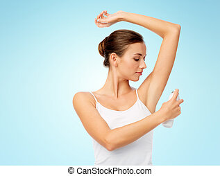 woman with antiperspirant deodorant over blue