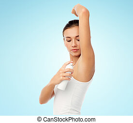 woman with antiperspirant deodorant over white