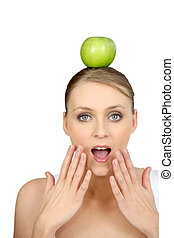 Woman with apple on head