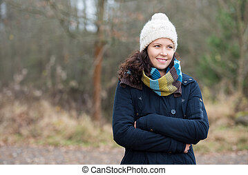 Woman With Arms Crossed In Winter Clothes Looking Away -...