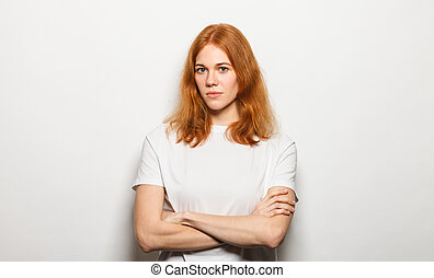 Woman with arms folded and looking at camera isolated on a white background