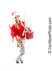 Woman with arms full of Christmas things shopping.