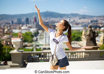 Woman with arms up enjoying sunny day
